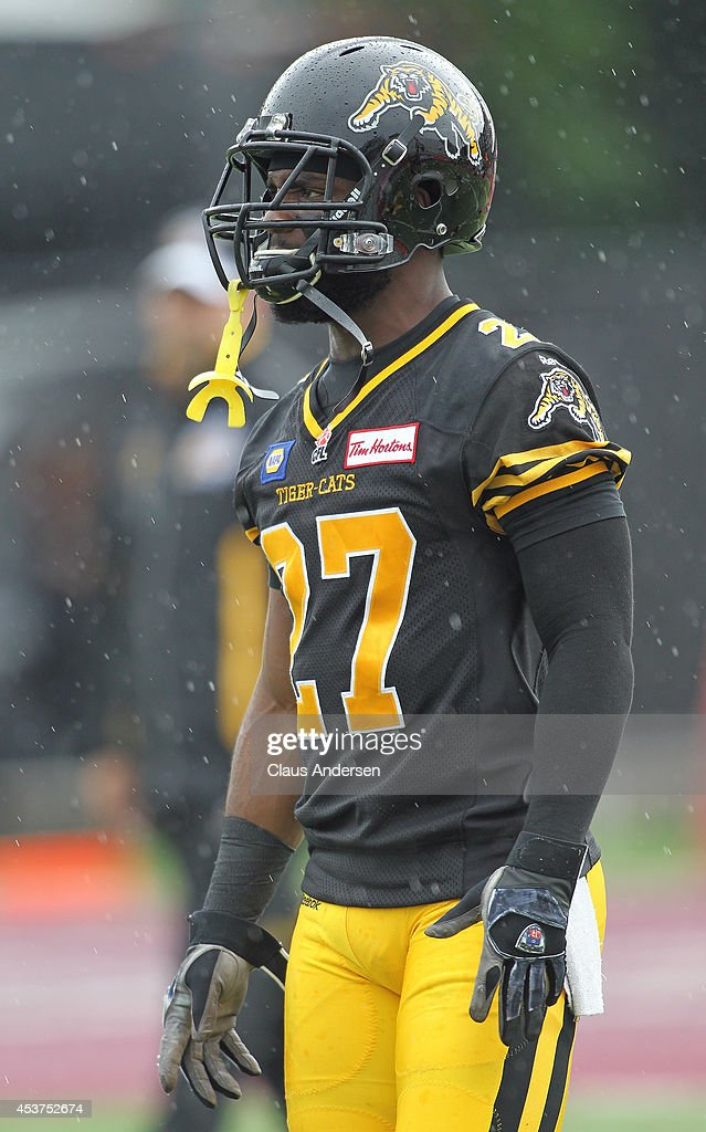 Delvin Breaux of the Hamilton TigerCats plays against the Calgary Stampeders in a CFL game at Ron Joyce Stadium on August 16 2014 in Hamilton Ontario...