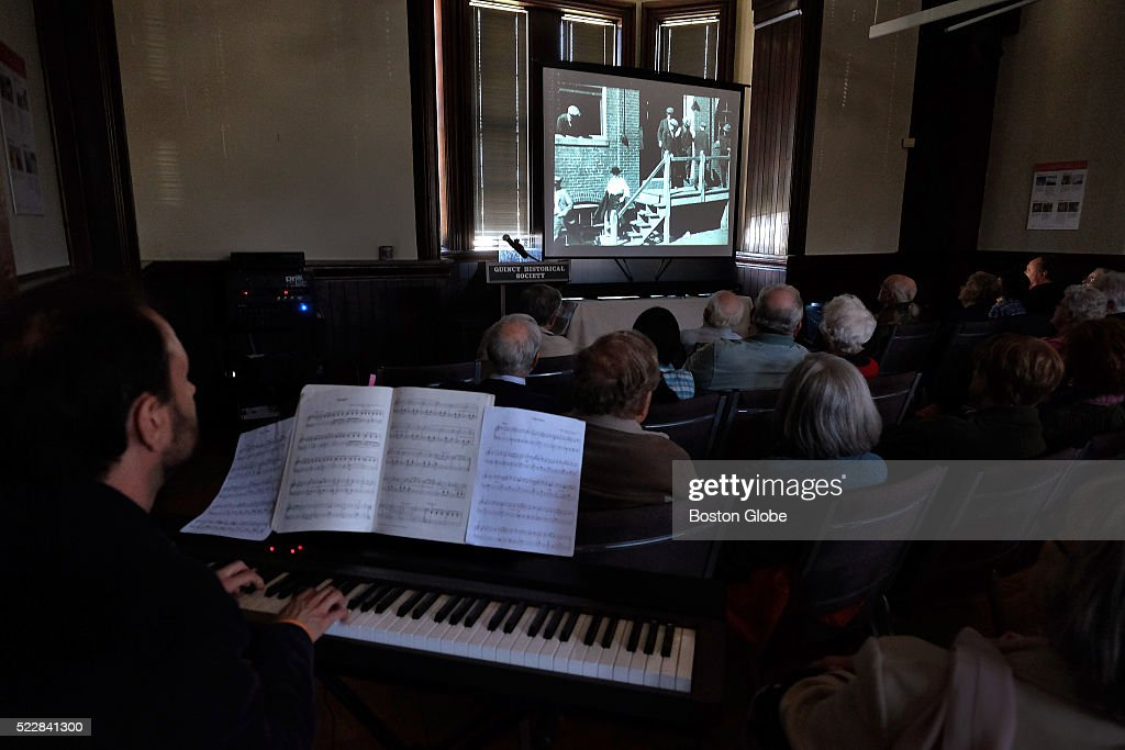 Delvyn Case, a resident of Quincy and a professor of music at Wheaton College, provided the musical piano accompaniment during the screening of the silent movie, 'A Romance of Quincy,' at the Quincy Historical Society.