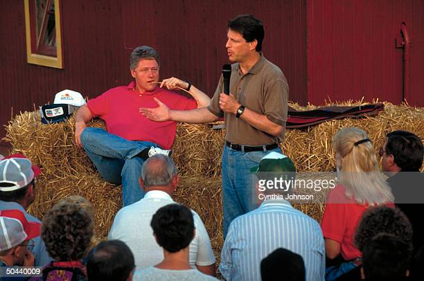 Dem running mates Bill Clinton Al Gore former lounging on haystack in town mtg at farm on cross country campaign bus tour