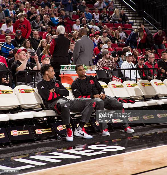 DeMar DeRozan and Kyle Lowry of the Toronto Raptors are seen during the game against the Portland Trail Blazers on December 26 2016 at the Moda...