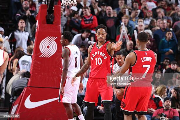 DeMar DeRozan and Kyle Lowry of the Toronto Raptors celebrate against the Portland Trail Blazers on December 26 2016 at the Moda Center in Portland...