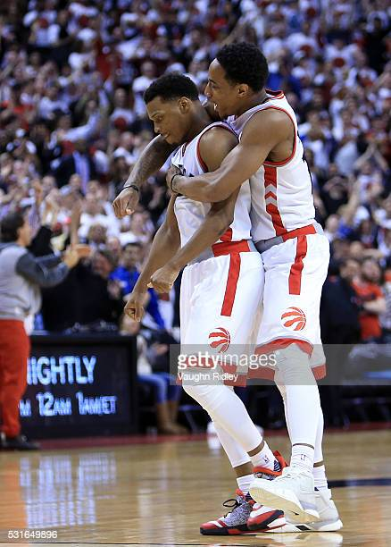 DeMar DeRozan and Kyle Lowry of the Toronto Raptors celebrate late in the second half of Game Seven of the Eastern Conference Quarterfinals against...