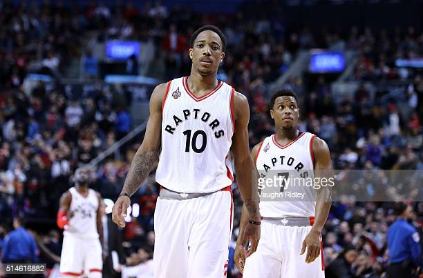 DeMar DeRozan and Kyle Lowry of the Toronto Raptors look on during the second half of an NBA game against the Houston Rockets at the Air Canada...