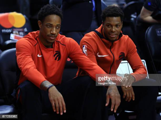 DeMar DeRozan and Kyle Lowry of the Toronto Raptors look on during warmup prior to the first half of an NBA game against the Washington Wizards at...