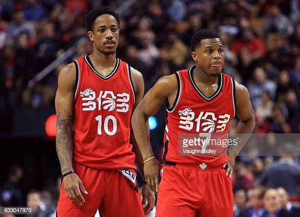 DeMar DeRozan and Kyle Lowry of the Toronto Raptors look on late in the second half of an NBA game against the Orlando Magic at Air Canada Centre on...