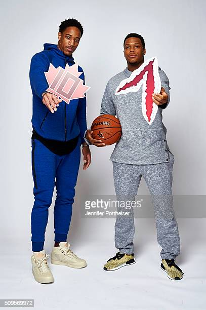 DeMar DeRozan and Kyle Lowry of the Toronto Raptors poses with their twitter emojis for a portrait on February 11 2016 at the Sheraton Centre in...