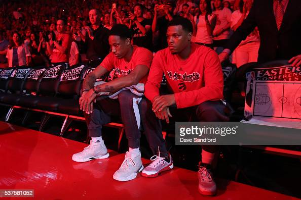 DeMar DeRozan and Kyle Lowry of the Toronto Raptors sit on the bench before Game Six of the NBA Eastern Conference Finals against the Cleveland...