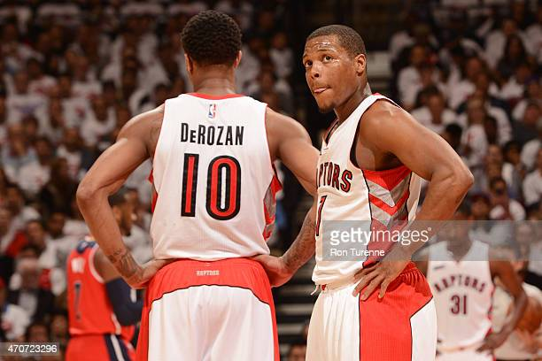 DeMar DeRozan and Kyle Lowry of the Toronto Raptors speak during a game against the Washington Wizards during Game Two of the Eastern Conference...