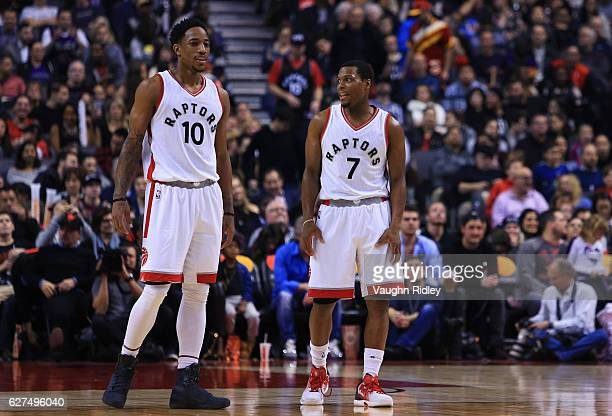 DeMar DeRozan and Kyle Lowry of the Toronto Raptors talk during the first half of an NBA game against the Atlanta Hawks at Air Canada Centre on...