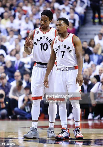 DeMar DeRozan and Kyle Lowry of the Toronto Raptors talk in the first half of Game Five of the Eastern Conference Semifinals against the Miami Heat...
