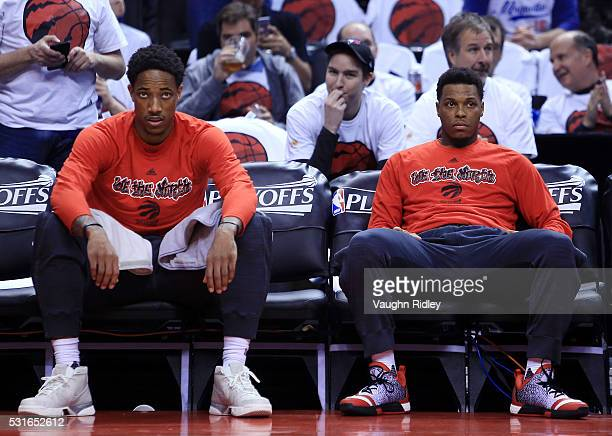 DeMar DeRozan and Kyle Lowry of the Toronto Raptors watch from the bench during warmup prior to Game Seven of the Eastern Conference Quarterfinals...