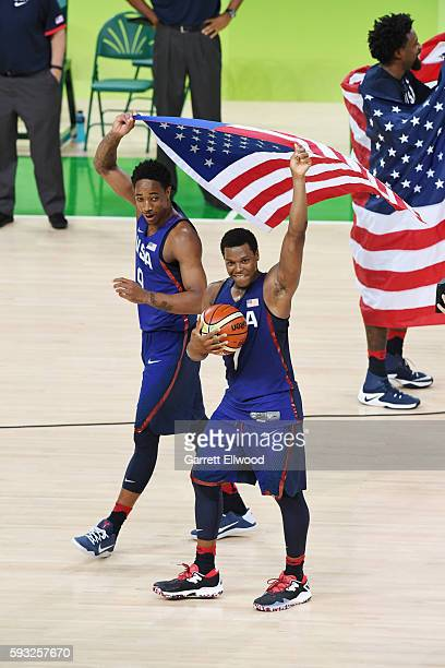DeMar DeRozan and Kyle Lowry of the USA Basketball Men's National Team celebrate after winning the Gold Medal Game against Serbia on Day 16 of the...