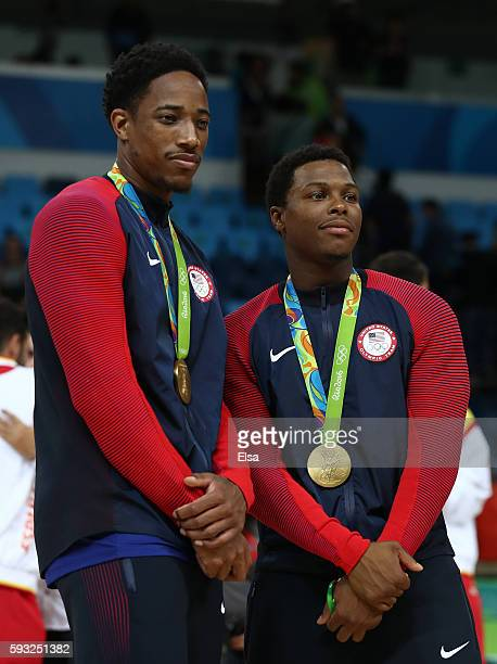 Demar DeRozan and Kyle Lowry stand on the podium with gold medals after defeating Serbia during the Men's Gold medal game on Day 16 of the Rio 2016...