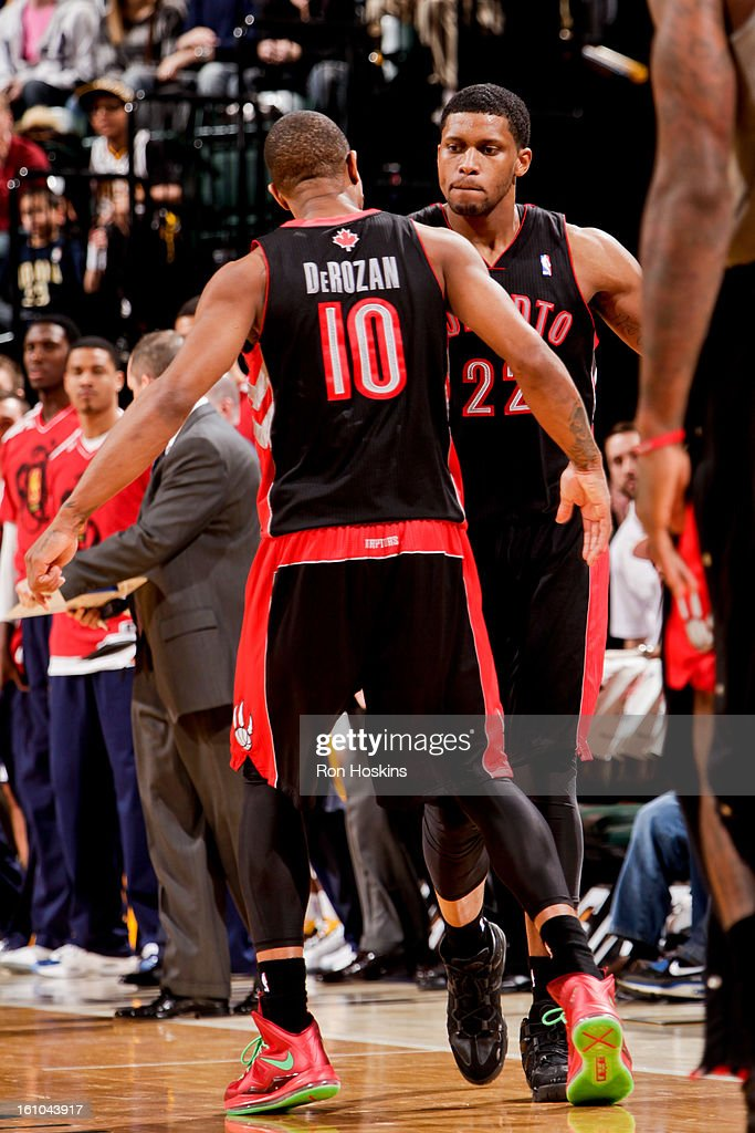 DeMar DeRozan #10 and <a gi-track='captionPersonalityLinkClicked' href=/galleries/search?phrase=Rudy+Gay&family=editorial&specificpeople=236066 ng-click='$event.stopPropagation()'>Rudy Gay</a> #22 of the Toronto Raptors celebrate while playing the Indiana Pacers on February 8, 2013 at Bankers Life Fieldhouse in Indianapolis, Indiana.