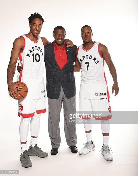 DeMar DeRozan Head Coach Dwane Casey and Kyle Lowry of the Toronto Raptors pose for a portrait during 2016 Media Day on September 28 2016 at the...