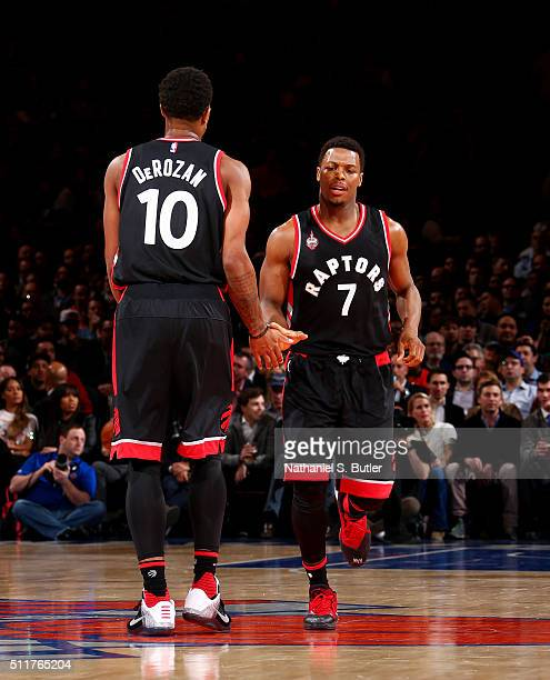 DeMar DeRozan high fives Kyle Lowry of the Toronto Raptors during the game against the New York Knicks on February 22 2016 at Madison Square Garden...