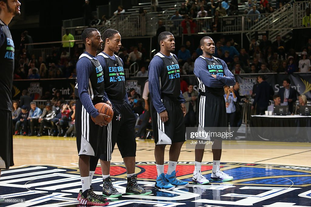 DeMar DeRozan #10, John Wall #2 and Joe Johnson #7 of the Eastern Conference All-Stars talk during the NBA All-Star Practices at Sprint Arena as part of 2014 NBA All-Star Weekend at the Ernest N. Morial Convention Center on February 15, 2014 in New Orleans, Louisiana.