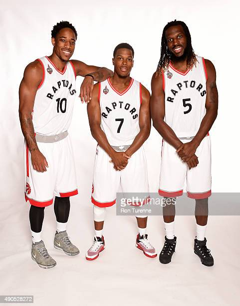 DeMar DeRozan Kyle Lowry and DeMarre Carroll of the Toronto Raptors poses for a photo during media day on September 28 at the Air Canada Centre in...