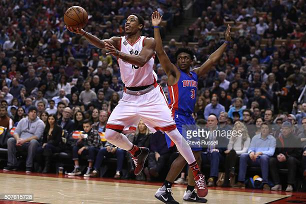 DeMar DeRozan lays the ball up after running past Stanley Johnson as the Toronto Raptors play the Detroit Pistons at the Air Canada Centre in Toronto...