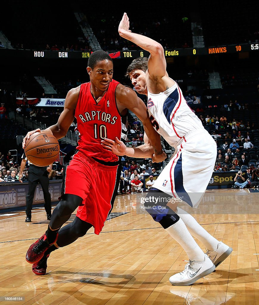 DeMar DeRozan #10 of the Toronto Raptors against Kyle Korver #26 of the Atlanta Hawks at Philips Arena on January 30, 2013 in Atlanta, Georgia.