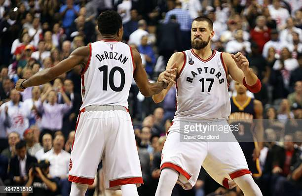 DeMar DeRozan of the Toronto Raptors and Jonas Valanciunas of the Toronto Raptors celebrate after a basket by Valanciunas against the Indiana Pacers...