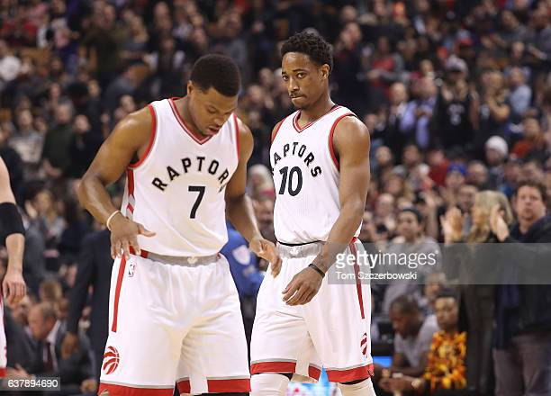 DeMar DeRozan of the Toronto Raptors and Kyle Lowry during their game against the Utah Jazz during NBA game action at Air Canada Centre on January 5...