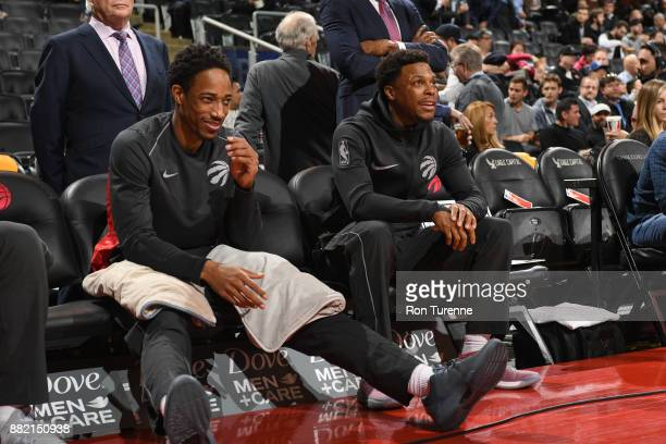 DeMar DeRozan of the Toronto Raptors and Kyle Lowry of the Toronto Raptors are seen before the game against the Charlotte Hornets on November 29 2017...