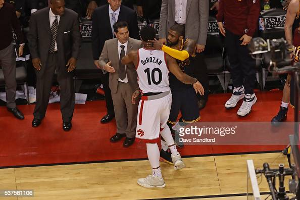DeMar DeRozan of the Toronto Raptors and Kyrie Irving of the Cleveland Cavaliers hug after Game Six of the NBA Eastern Conference Finals at Air...
