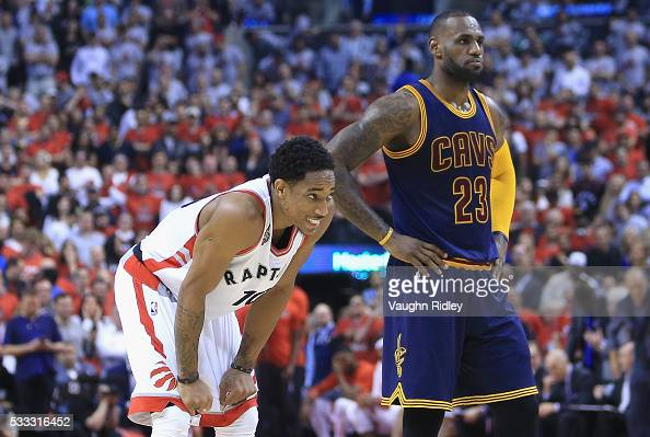 DeMar DeRozan of the Toronto Raptors and LeBron James of the Cleveland Cavaliers look on during the first half in game three of the Eastern...