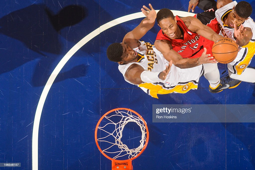 DeMar DeRozan #10 of the Toronto Raptors attempts a shot against <a gi-track='captionPersonalityLinkClicked' href=/galleries/search?phrase=Roy+Hibbert&family=editorial&specificpeople=725128 ng-click='$event.stopPropagation()'>Roy Hibbert</a> #55 and Paul George #24 of the Indiana Pacers on November 13, 2012 at Bankers Life Fieldhouse in Indianapolis, Indiana.