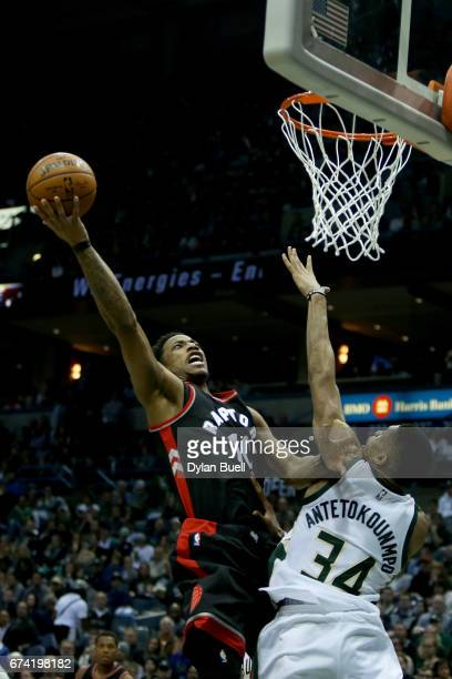 DeMar DeRozan of the Toronto Raptors attempts a shot over Giannis Antetokounmpo of the Milwaukee Bucks in the third quarter in Game Six of the...