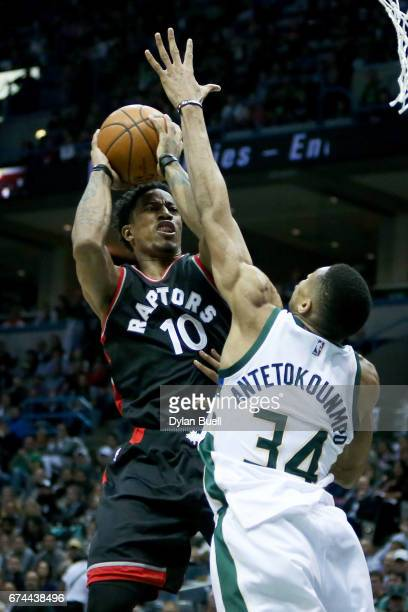 DeMar DeRozan of the Toronto Raptors attempts a shot while being guarded by Giannis Antetokounmpo of the Milwaukee Bucks in the third quarter in Game...