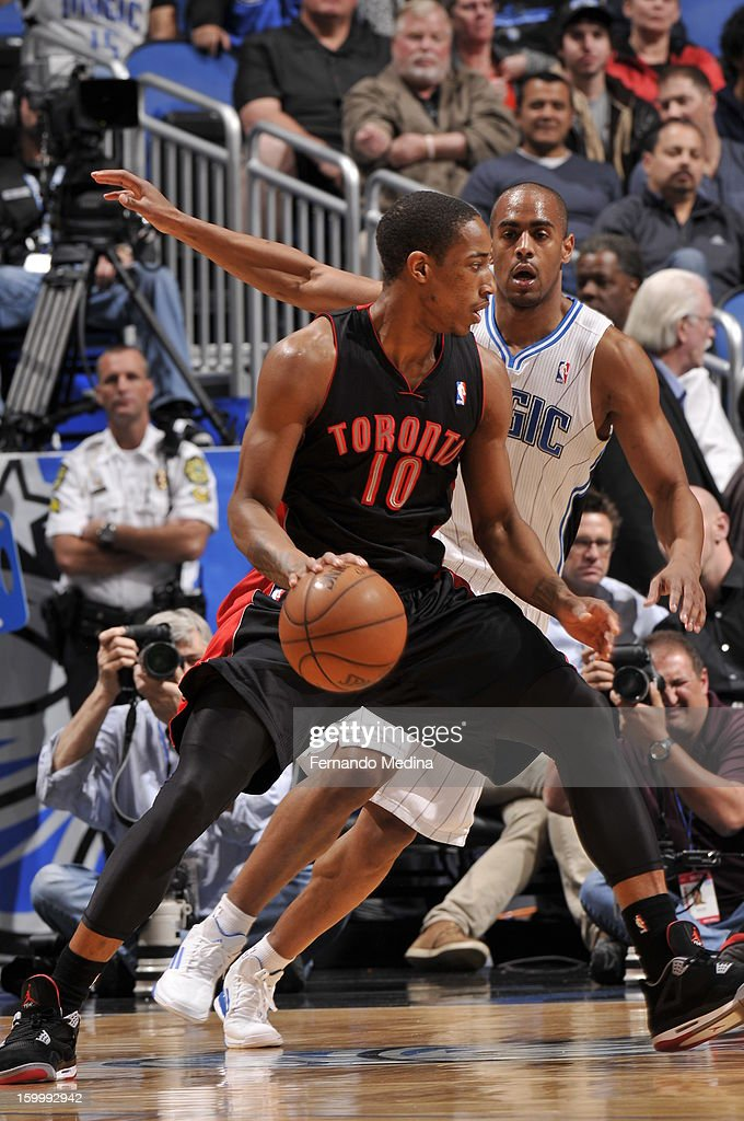 DeMar DeRozan #10 of the Toronto Raptors backs up to the basket against Arron Afflalo #4 of the Orlando Magic during the game on January 24, 2013 at Amway Center in Orlando, Florida.