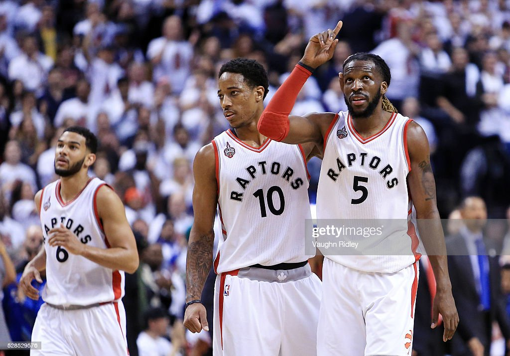 DeMar DeRozan #10 of the Toronto Raptors congratulates DeMarre Carroll #5 after Carroll scored a basket in overtime of Game Two of the Eastern Conference Semifinals during the 2016 NBA Playoffs at the Air Canada Centre on May 5, 2016 in Toronto, Ontario, Canada.