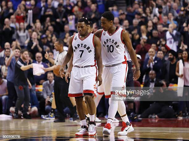 DeMar DeRozan of the Toronto Raptors consoles Kyle Lowry during an NBA game against the Golden State Warriors at the Air Canada Centre on December 05...