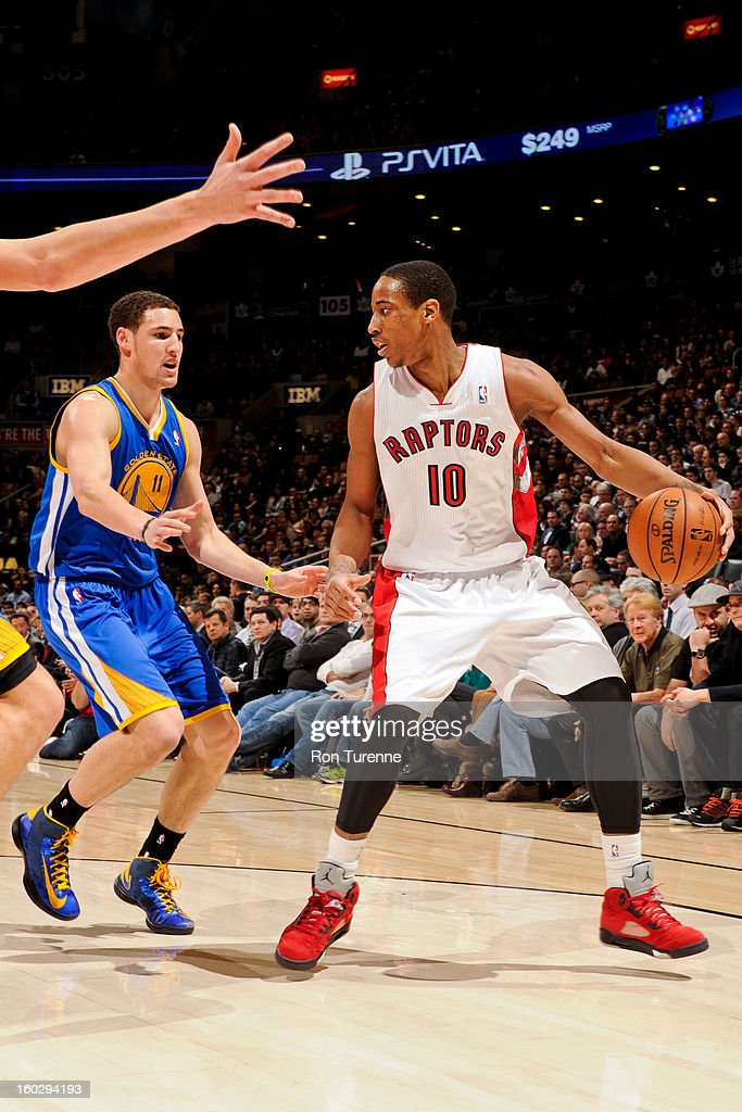 DeMar DeRozan #10 of the Toronto Raptors controls the ball against Klay Thompson #11 of the Golden State Warriors on January 28, 2013 at the Air Canada Centre in Toronto, Ontario, Canada.