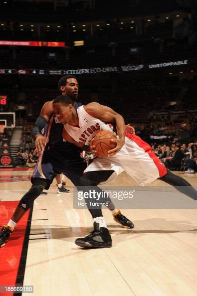 DeMar DeRozan of the Toronto Raptors defends the ball against Mike Conley of the Memphis Grizzlies during the game on October 23 2013 at the Air...