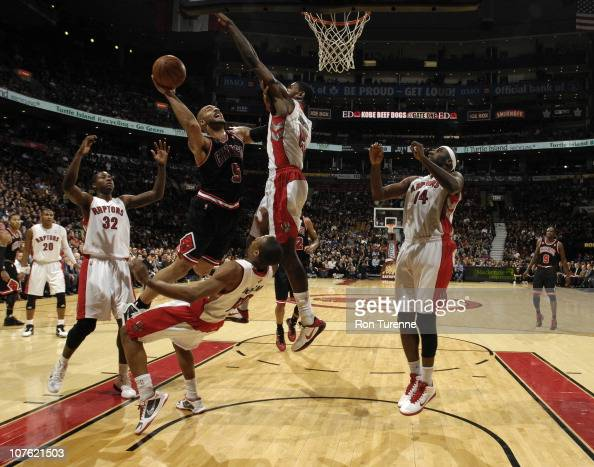 DeMar DeRozan of the Toronto Raptors draws the charge against Carlos Boozer of the Chicago Bulls during a game on December 15 2010 at the Air Canada...