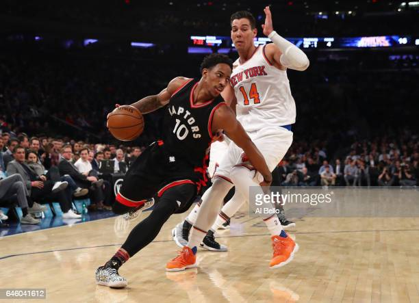 DeMar DeRozan of the Toronto Raptors dribbles against Willy Hernangomez of the New York Knicks during their game at Madison Square Garden on February...