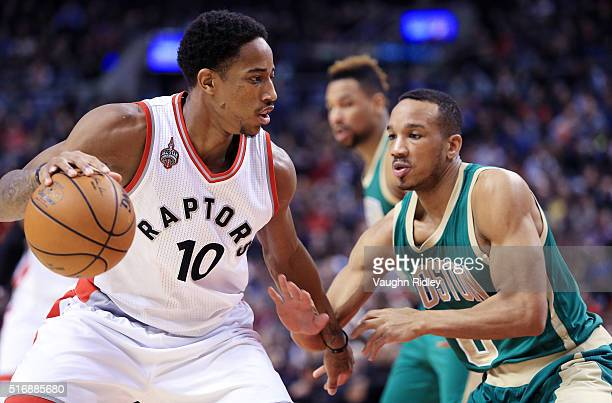 DeMar DeRozan of the Toronto Raptors dribbles the ball as Avery Bradley of the Boston Celtics defends during the first half of an NBA game at the Air...