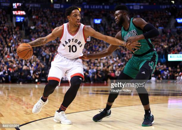 DeMar DeRozan of the Toronto Raptors dribbles the ball as Jaylen Brown of the Boston Celtics defends during an NBA game at Air Canada Centre on...
