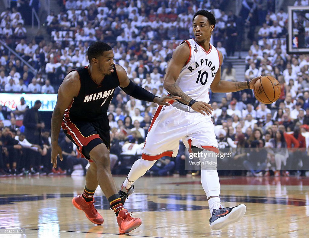 DeMar DeRozan #10 of the Toronto Raptors dribbles the ball as <a gi-track='captionPersonalityLinkClicked' href=/galleries/search?phrase=Joe+Johnson+-+Basketball+Player&family=editorial&specificpeople=201652 ng-click='$event.stopPropagation()'>Joe Johnson</a> #2 of the Miami Heat defends in the first half of Game Two of the Eastern Conference Semifinals during the 2016 NBA Playoffs at the Air Canada Centre on May 5, 2016 in Toronto, Ontario, Canada.