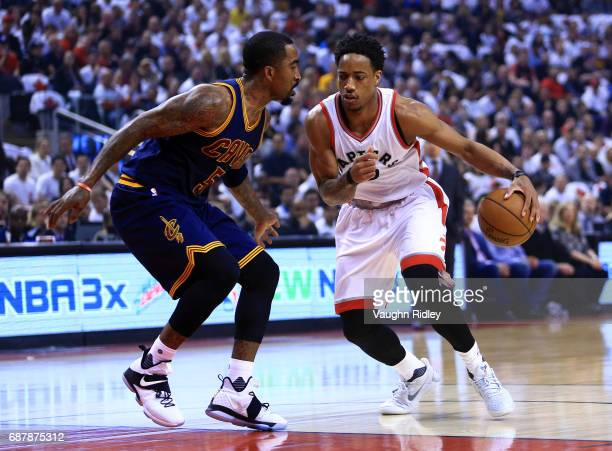 DeMar DeRozan of the Toronto Raptors dribbles the ball as JR Smith of the Cleveland Cavaliers defends in the first half of Game Three of the Eastern...