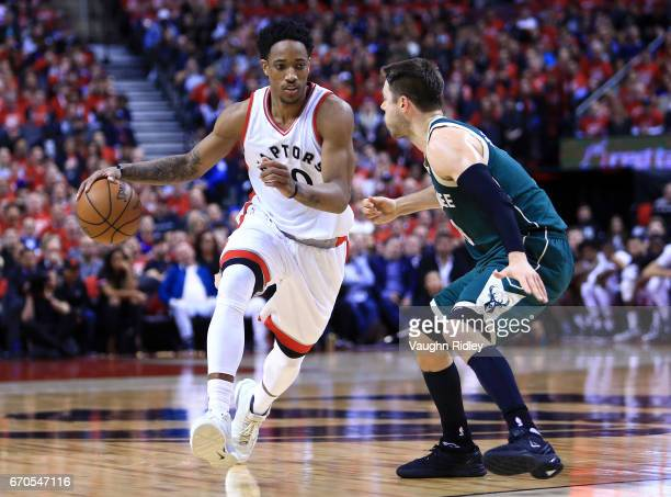 DeMar DeRozan of the Toronto Raptors dribbles the ball as Matthew Dellavedova of the Milwaukee Bucks defends in the second half of Game Two of the...