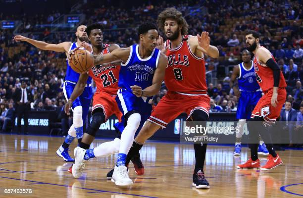 DeMar DeRozan of the Toronto Raptors dribbles the ball as Robin Lopez of the Chicago Bulls defends during the first half of an NBA game at Air Canada...