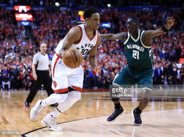 DeMar DeRozan of the Toronto Raptors dribbles the ball as Tony Snell of the Milwaukee Bucks defends in the second half of Game Two of the Eastern...