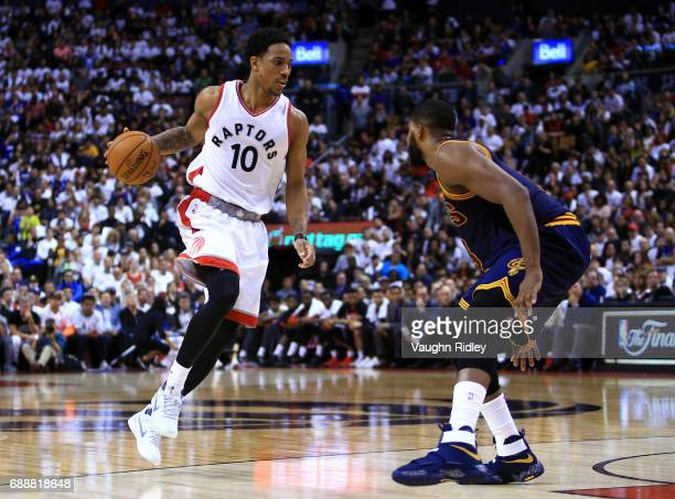 DeMar DeRozan of the Toronto Raptors dribbles the ball as Tristan Thompson of the Cleveland Cavaliers defends in the second half of Game Four of the...