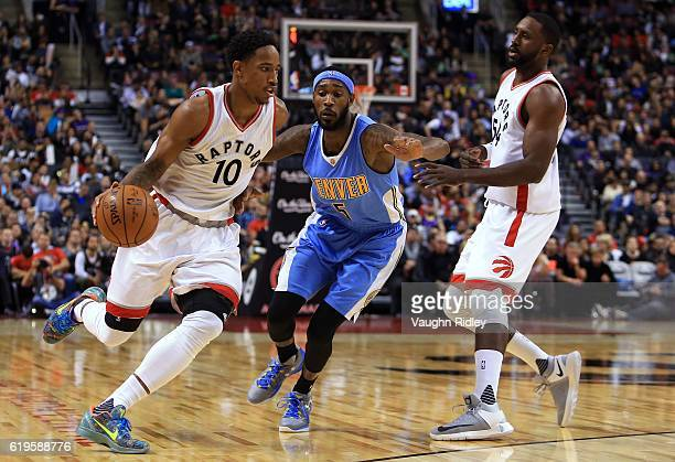 DeMar DeRozan of the Toronto Raptors dribbles the ball as Will Barton of the Denver Nuggets defends during the second half of an NBA game at Air...