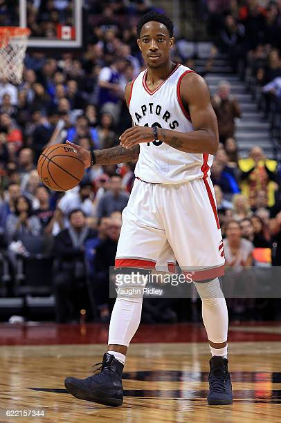 DeMar DeRozan of the Toronto Raptors dribbles the ball during the second half of an NBA game against the Denver Nuggets at Air Canada Centre on...