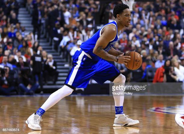 DeMar DeRozan of the Toronto Raptors dribbles the ball during the first half of an NBA game against the Chicago Bulls at Air Canada Centre on March...